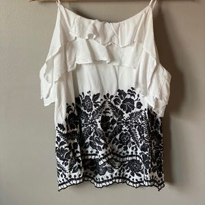 Off the shoulder black and white top.